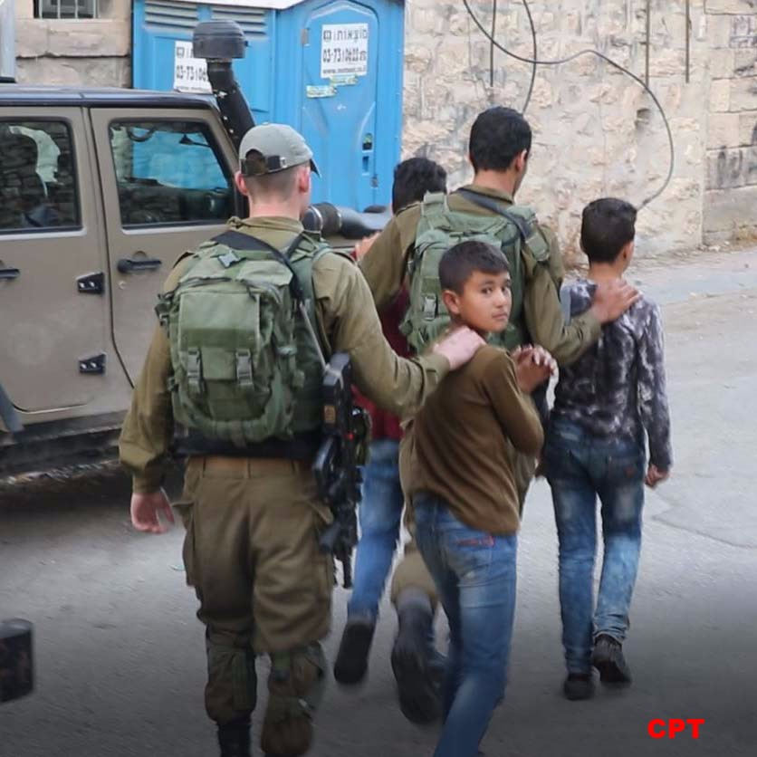 Israeli soldiers detain a Palestinian minor inside of Hebron's Old City on October 13, 2017. (Photo: Christian Peacemakers Team)