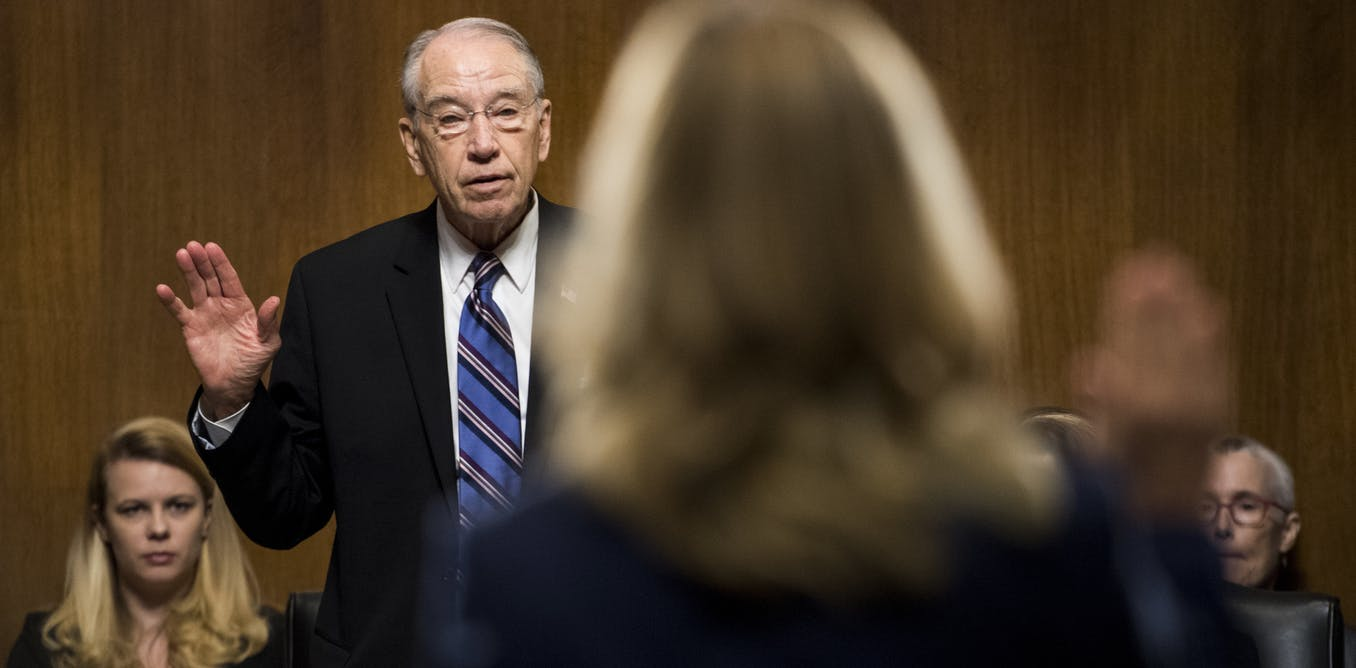 Christine Blasey Ford is sworn in by Chairman Chuck Grassley