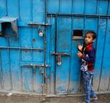A boy stands near the main gate of the orphanage in Dhaka | Mahmud Hossain Opu/Dhaka Tribune